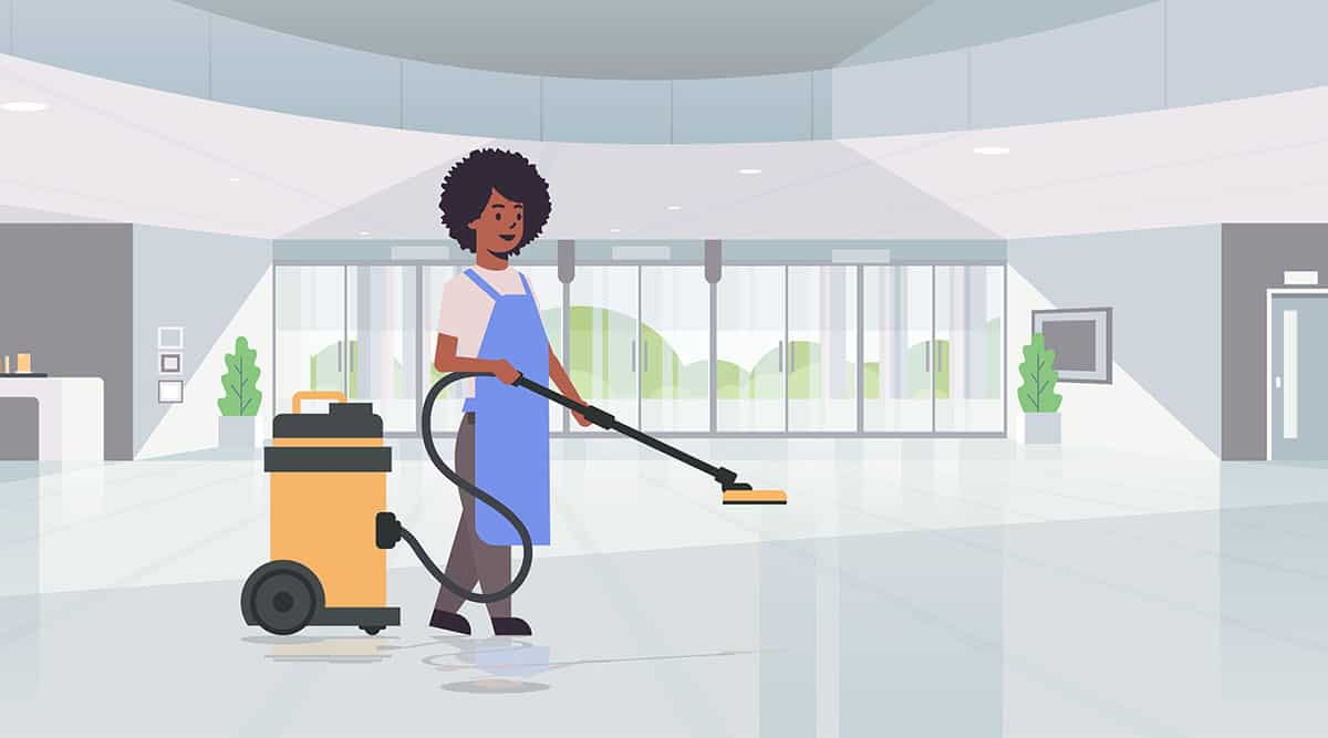 Illustration of a cleaner vacuuming floor in office