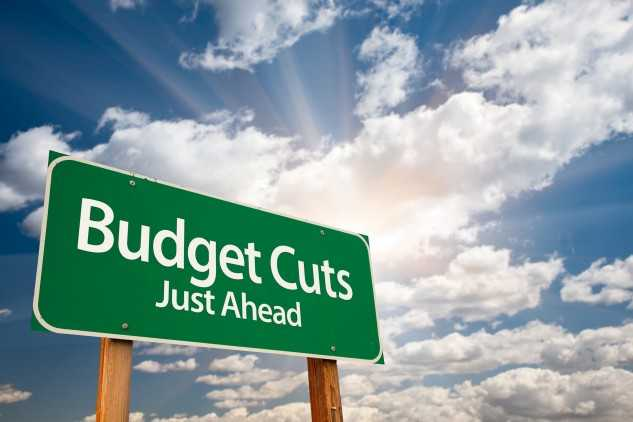 Sign saying budget cuts just ahead