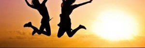 Happy people jumping for joy