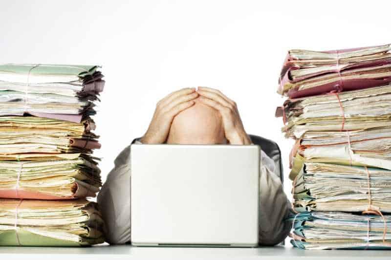 Paperwork making worker stressed