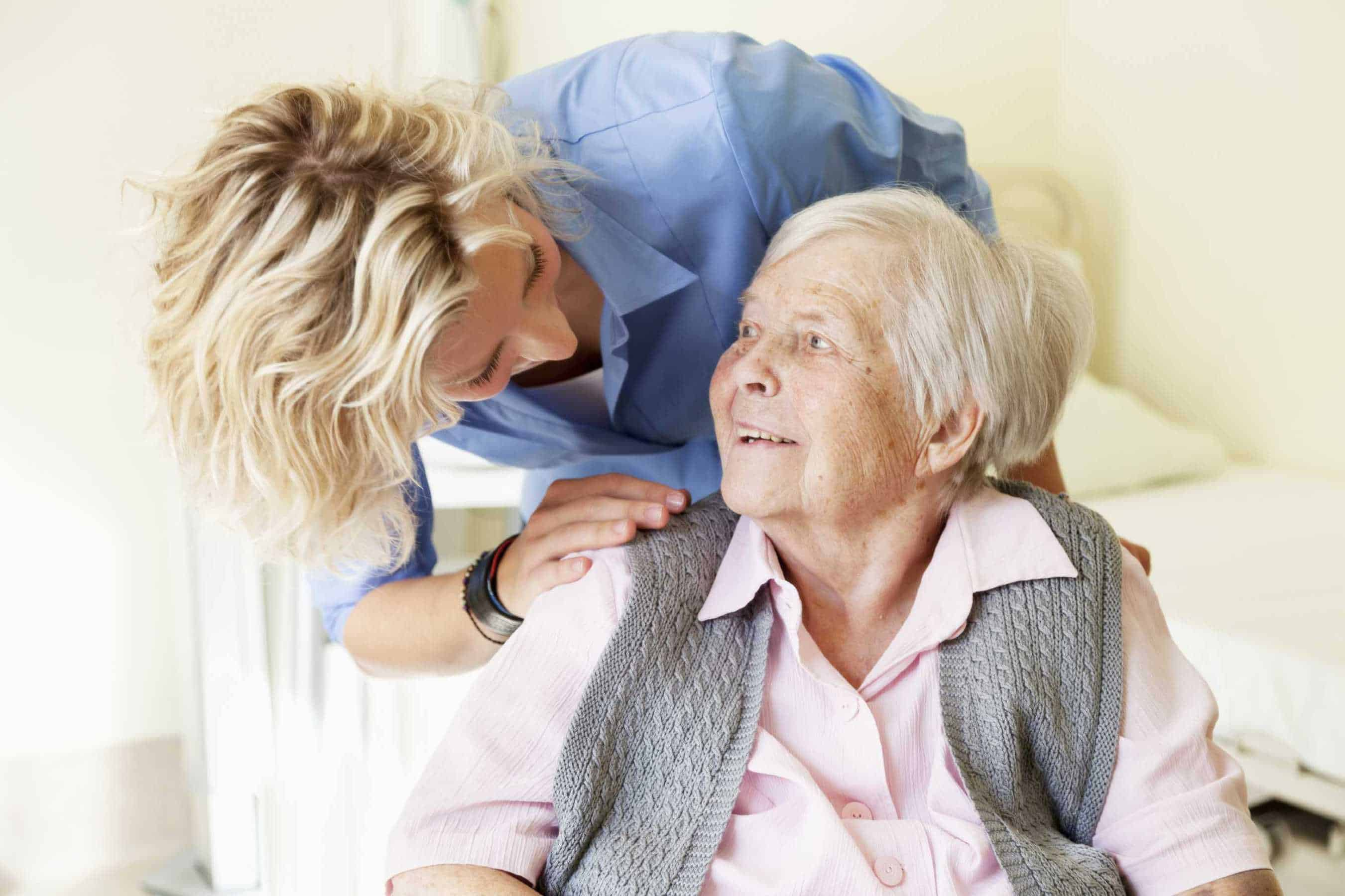 Carer and client smiling at eachother