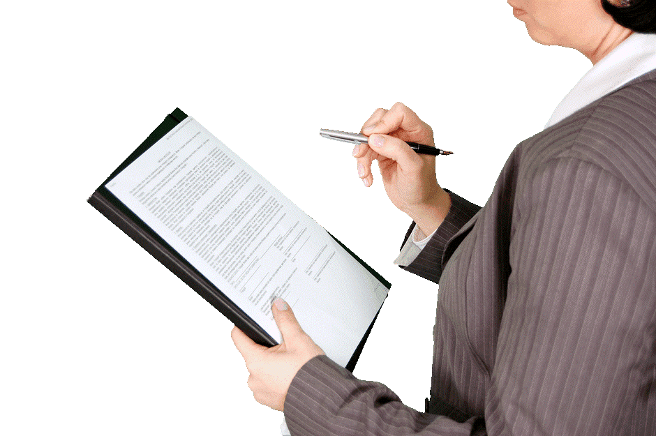 Female holding a piece of paper with a pen