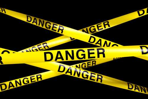 3d rendering of caution tape with DANGER written on it