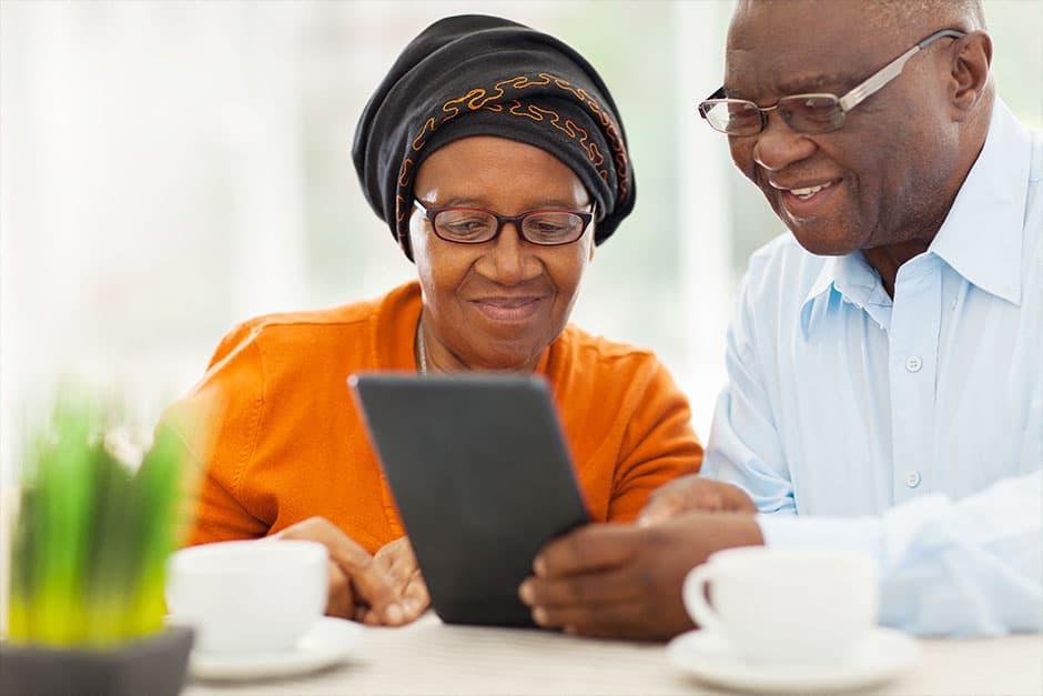 Senior couple using tablet