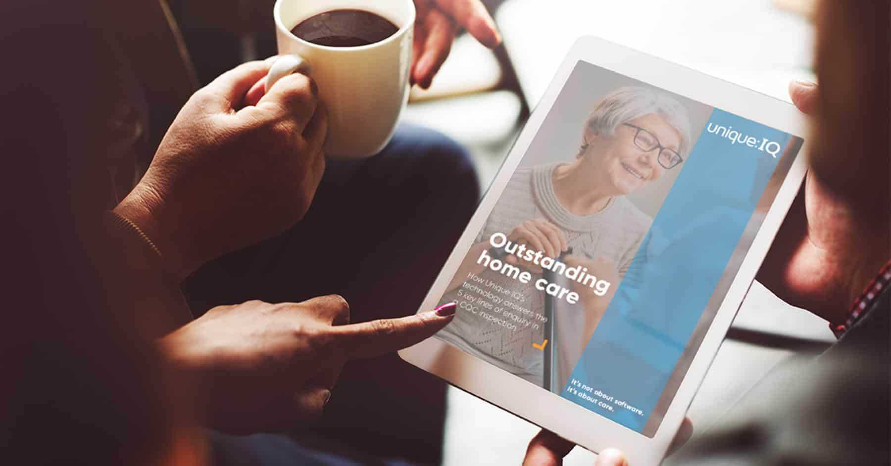 care workers reading guide to outstanding cqc home care