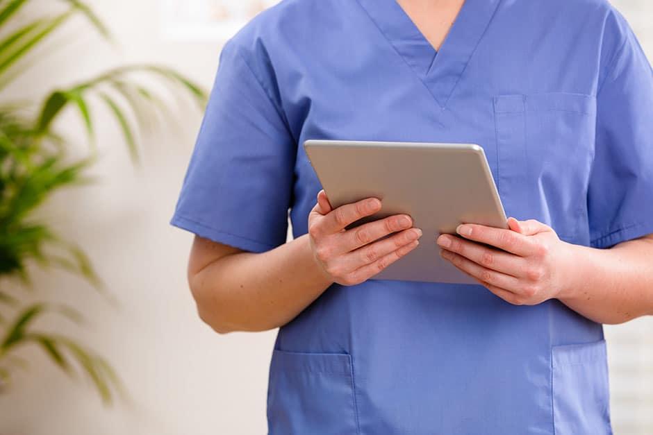 Carer examining digital care records
